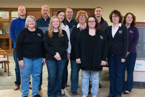 Photo of group of bank employees wearing jeans